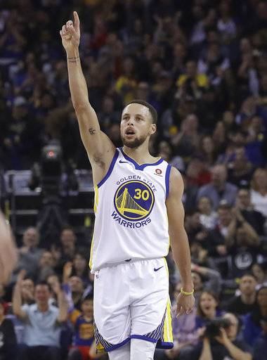 Golden State Warriors guard Stephen Curry (30) reacts after scoring against the Brooklyn Nets during the first half of an NBA basketball game in Oakland, Calif., Tuesday, March 6, 2018.