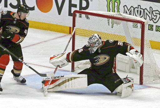 Anaheim Ducks goalie John Gibson (36) blocks a shot by the Washington Capitals during the second period of an NHL hockey game in Anaheim, Calif., Tuesday, March 6, 2018.