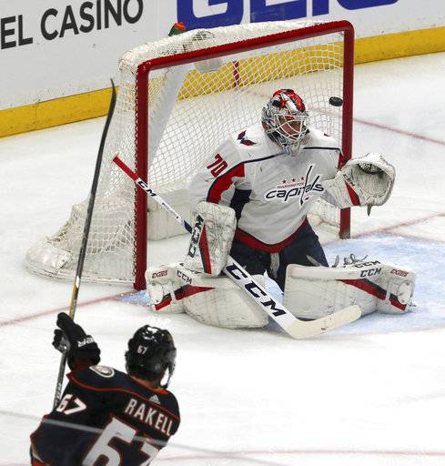 Anaheim Ducks center Rickard Rakell (67) puts the puck in the goal past Washington Capitals goalie Brandon Holtby (70) during the second period of an NHL hockey game in Anaheim, Calif., Tuesday, March 6, 2018.