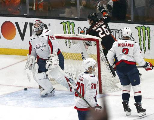 Anaheim Ducks defenseman Brandon Montour (26) celebrates a goal by defenseman Hampus Lindholm, not seen, as Washington Capitals goalie Brandon Holtby (70) looks up during the first period of an NHL hockey game in Anaheim, Calif., Tuesday, March 6, 2018.