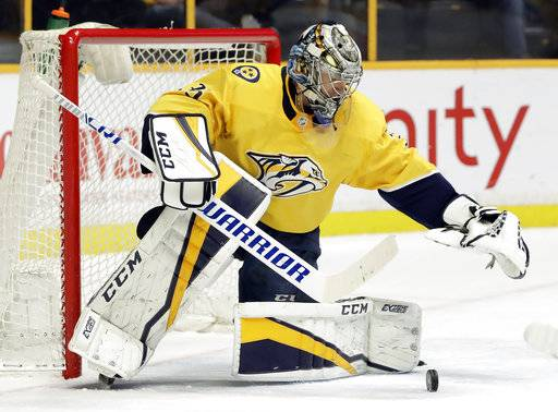 Nashville Predators goalie Pekka Rinne, of Finland, blocks a shot against the Dallas Stars in the first period of an NHL hockey game Tuesday, March 6, 2018, in Nashville, Tenn.
