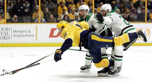 Dallas Stars defenseman Greg Pateryn, right takes down Nashville Predators center Colton Sissons (10) in the second period of an NHL hockey game Tuesday, March 6, 2018, in Nashville, Tenn. Pattern was penalized for holding.