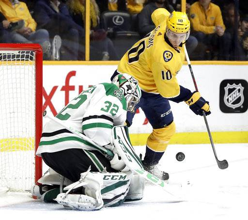 Dallas Stars goalie Kari Lehtonen (32), of Finland, blocks a shot as Nashville Predators center Colton Sissons (10) watches for the rebound in the second period of an NHL hockey game Tuesday, March 6, 2018, in Nashville, Tenn.