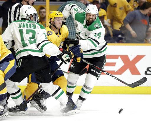 Nashville Predators' Colton Sissons, center, tries to move past Dallas Stars' Mattias Janmark (13), of Sweden, of the Czech Republic, and Jamie Benn (14) in the first period of an NHL hockey game Tuesday, March 6, 2018, in Nashville, Tenn.