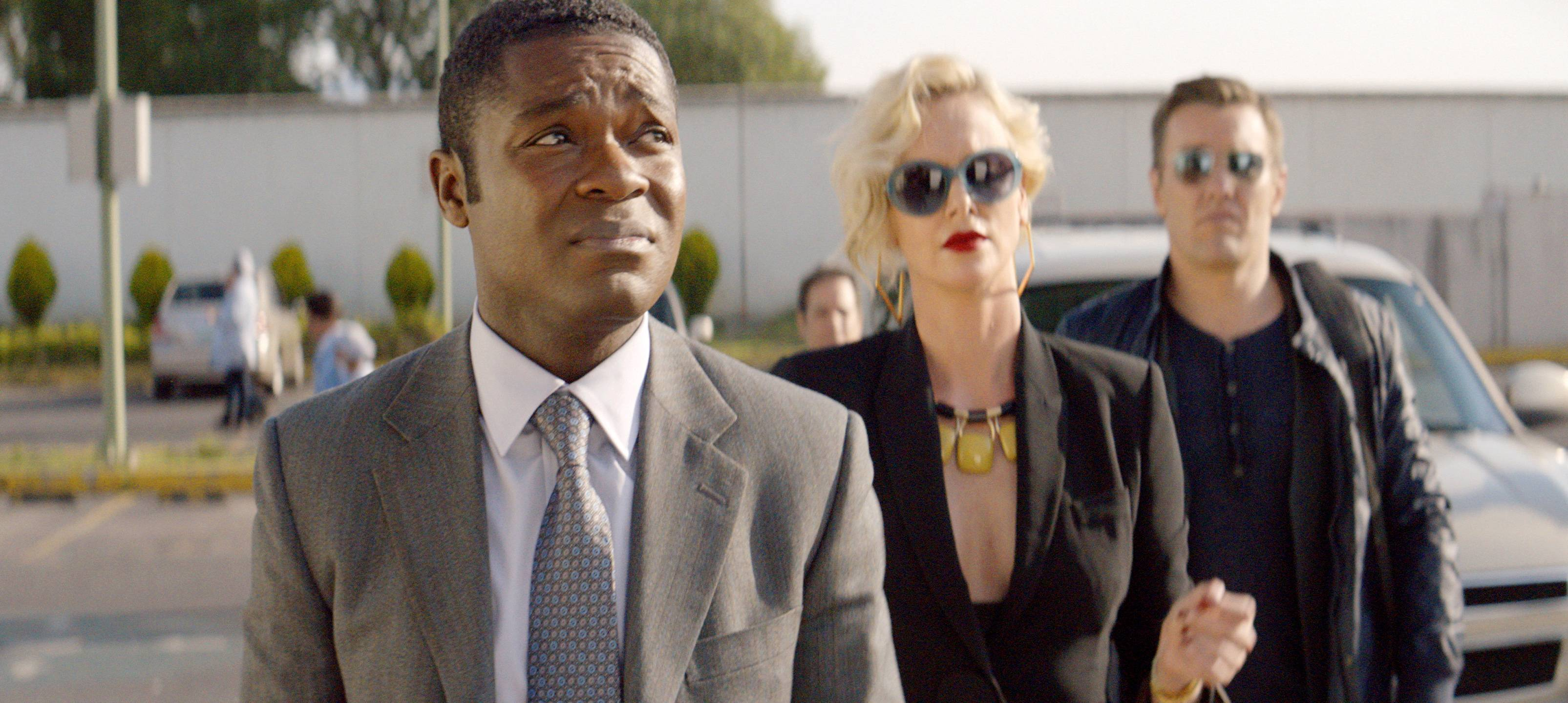 "Harold (David Oyelowo), left, gets caught up in a mess created by his bosses (Charlize Theron and Joel Edgerton) in ""Gringo."""