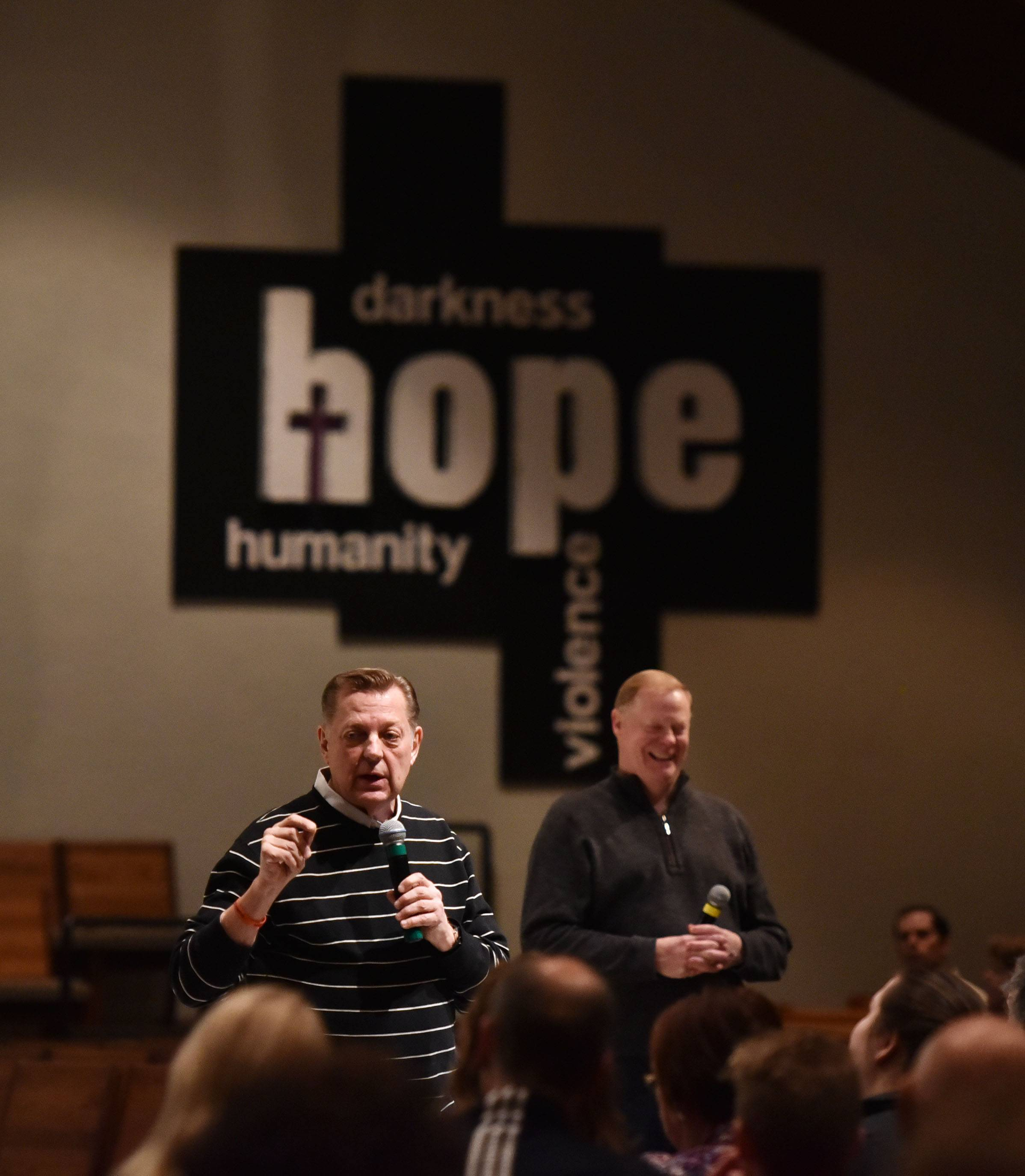 Chicago activist priest Michael Pfleger speaks at Holy Family Catholic Community Church in Inverness Thursday night about his Strong Futures Program. Behind him is the Rev. Terry Keehan, pastor of Holy Family.