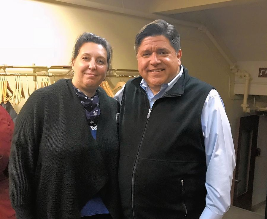 Democratic candidate for governor J.B. Pritzker poses for a photo with supporter Jax West of Lisle, who organized a recent meet-and-greet for the Hyatt hotel heir.