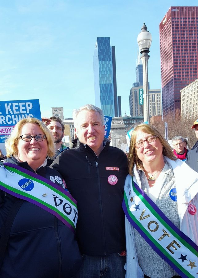 Democratic Committeewoman Tina Tyson-Dunne, left, and her mother, Holly Tyson, stand with Democratic gubernatorial candidate Chris Kennedy at the Women's March in Chicago Jan. 20.