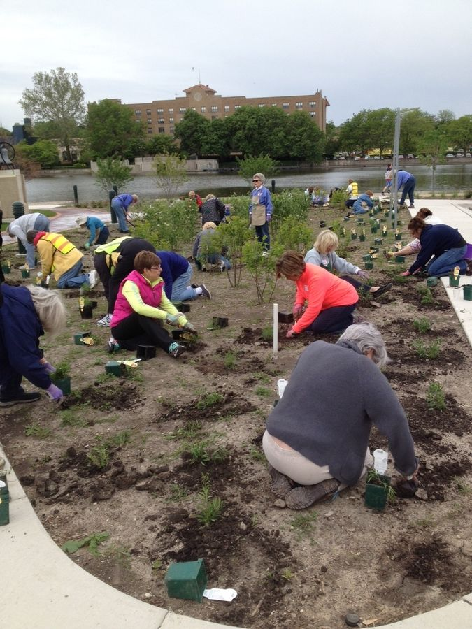 Members of the Pottawatomie Garden Club work on plantings along the Fox River Corridor walkway in St. Charles. The club will celebrate its 90th anniversary this year.