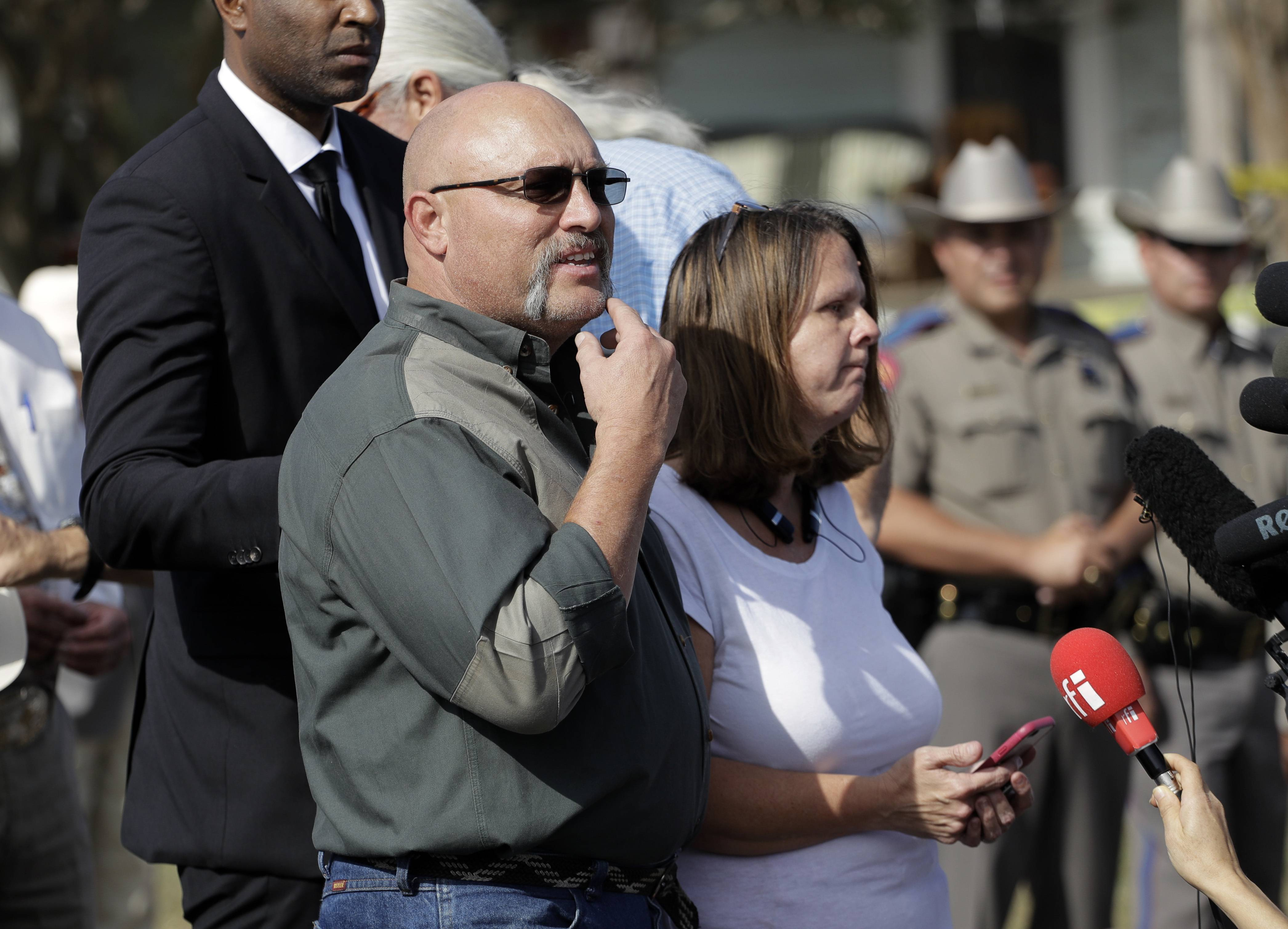 Pastor Frank Pomeroy, shown here with his wife, Sherri, at a news conference near the First Baptist Church of Sutherland Springs after the shooting, confronted two conspiracy theorists who say the mass shooting was staged.