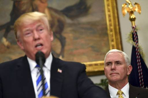 Vice President Mike Pence, right, listens as President Donald Trump speaks in the Roosevelt Room at the White House in Washington, Thursday, March 8, 2018, during an event where Trump signed two proclamations, one on steel imports and the other on aluminum imports.