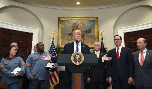 President Donald Trump, center, speaks in the Roosevelt Room of the White House in Washington, Thursday, March 8, 2018, before signing two proclamations, one on steel imports and one on aluminum imports. Standing with Trump are workers, left, Vice President Mike Pence, Treasury Secretary Steven Mnuchin and Commerce Secretary Wilbur Ross.