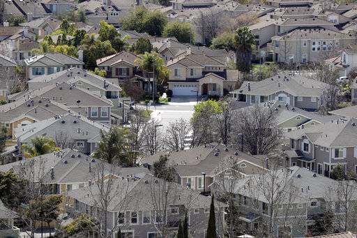 In this Tuesday, March 6, 2018, photo homes stack up in a neighborhood in San Jose, Calif. NerdWallet calculated affordability for 173 metropolitan areas by comparing the median annual household income and the monthly principal-and-interest payment for a median-priced single-family home and found that the least affordable homes are in the San Jose.