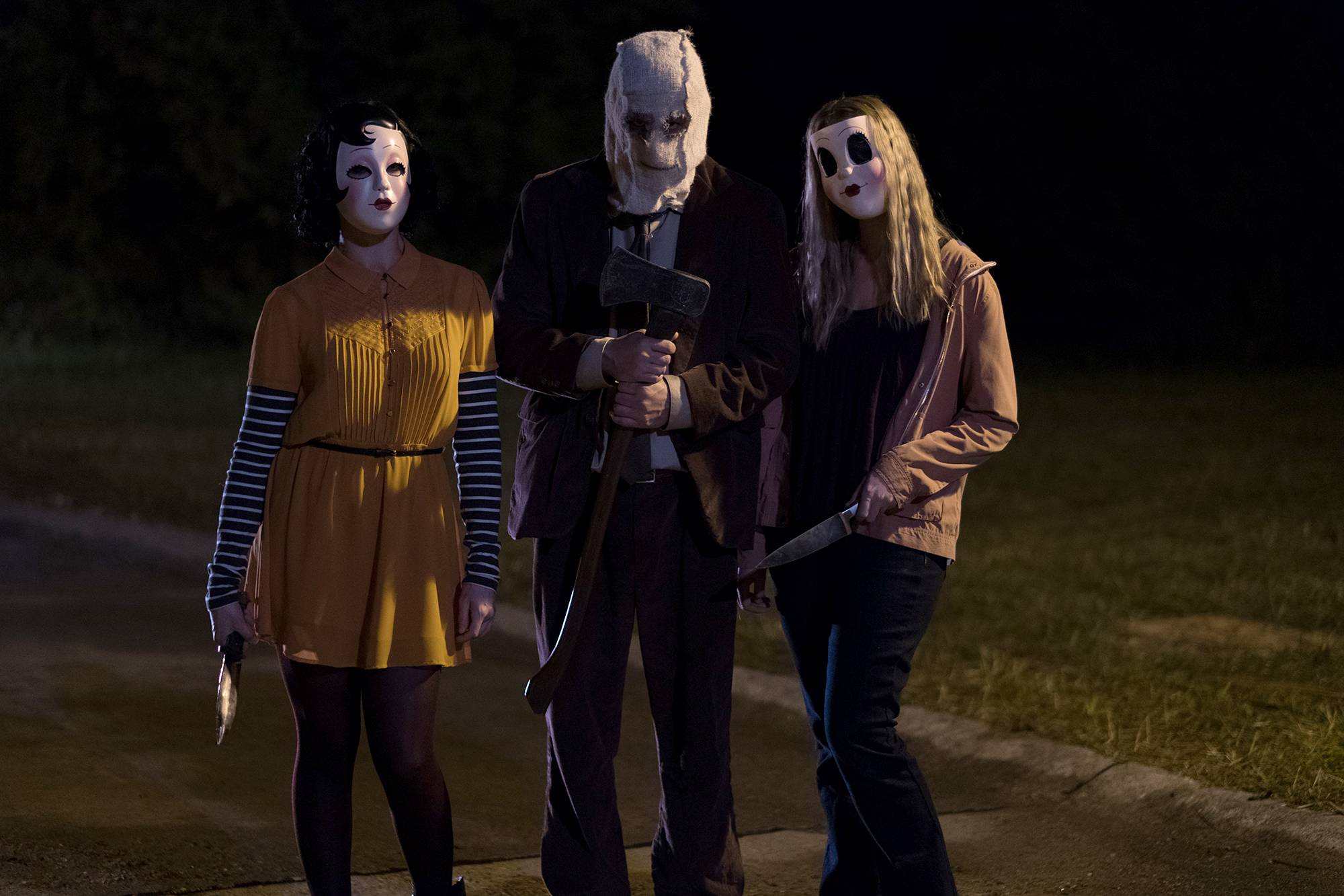 "Pinup Girl, Man in the Mask and Dollface terrorize a family in ""The Strangers: Prey at Night."""