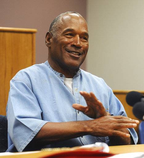 "FILE - In this July 20, 2017 file photo, former NFL football star O.J. Simpson attends his parole hearing at the Lovelock Correctional Center in Lovelock, Nev. Fox TV will air an O.J. Simpson special including an unseen 2006 interview in which he theorizes about what happened the night his ex-wife was murdered. The two-hour special, with the provocative title ""O.J. Simpson: The Lost Confession?"" will air 8 p.m. EST Sunday, March 11. Soledad O'Brien is the host. (Jason Bean/The Reno Gazette-Journal via AP, Pool)"