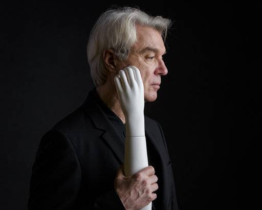"In this Feb. 16, 2018 photo, musician David Byrne poses for a portrait in New York to promote his album, ""American Utopia,"" which will be released on Friday, March 9. (Photo by Drew Gurian/Invision/AP)"