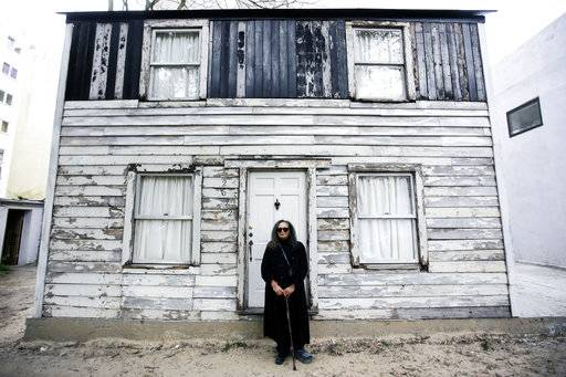 FILE - In this April 6, 2017 file photo, Rhea McCauley, a niece of the late civil rights activist Rosa Parks, poses in front of the rebuilt house of Rosa Parks in Berlin. Brown University announced Thursday, March 8, 2018, it has canceled plans to display the house where Rosa Parks lived after sparking the Montgomery bus boycott.