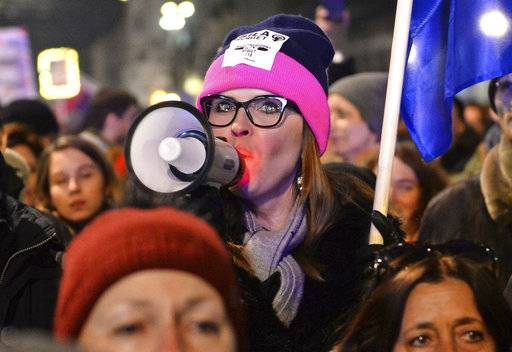 Protesters take part in a Women's Day march in Warsaw, Poland, Thursday, March 8, 2018. A few thousand women and men chanting women's rights slogans marched through  central Warsaw to mark the International Women's Day.