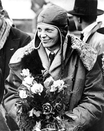 "FILE - In a June 26, 1928 file photo, American aviatrix Amelia Earhart poses with flowers as she arrives in Southampton, England, after her transatlantic flight on the ""Friendship"" from Burry Point, Wales. Bones found in 1940 on a western Pacific Ocean island were quite likely to be remains from famed aviator Amelia Earhart, a new analysis concludes. Until somebody disproves the link, ""the most convincing argument is that they are hers,� University of Tennessee anthropologist Richard Jantz said in a statement from the institution."