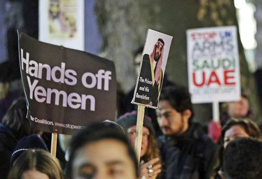 Protesters in Whitehall, London, demonstrate against the official visit by Saudi Arabia's Crown Prince Mohammed bin Salman, Wednesday March 7, 2018. Mohammed bin Salman received a royal welcome and high level political meetings, while being criticized by protesters against the war in Yemen, as he began a three-day visit to Britain on Wednesday. (Yui Mok/PA via AP)