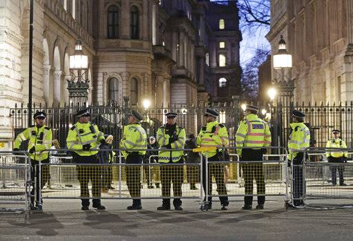 British police officers secure the area outside Downing Street in London, as protesters demonstrate against the visit by Saudi Arabia's Crown Prince Mohammed bin Salman, Wednesday March 7, 2018.  Saudi Arabia's Crown Prince Mohammed bin Salman received a royal welcome with high level political talks to begin his three day visit to Britain, although protesters criticised the visit. (Yui Mok/PA via AP)