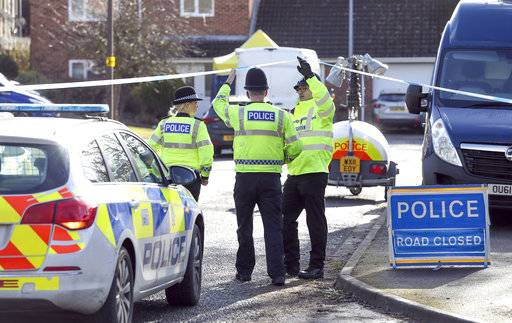 Police officers seal off a cul-de-sac in Salisbury, England, near to the home of former Russian ex-spy Sergei Skripal as a nerve agent is believed to have been used to critically injure him and his daughter Yulia. Britain's Home Secretary says the investigation into the nerve agent attack on a Russian ex-spy and his daughter is focusing on three sites - his home, a pub and a restaurant. (Andrew Matthews/PA via AP)