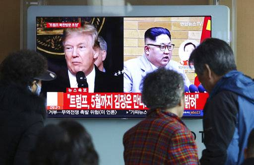 "People watch a TV screen showing North Korean leader Kim Jong Un and U.S. President Donald Trump, left, at the Seoul Railway Station in Seoul, South Korea, Friday, March 9, 2018. Trump has accepted an offer of a summit from the North Korean leader and will meet with Kim Jong Un by May, a top South Korean official said Thursday, in a remarkable turnaround in relations between two historic adversaries. The signs read: "" Trump has accepted an offer of a summit from the North Korean leader and will meet with Kim by May."""