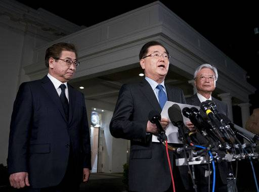 South Korean national security director Chung Eui-yong, center, speaks to reporters at the White House in Washington, Thursday, March 8, 2018, as intelligence chief Suh Hoon, left and Cho Yoon-je, the South Korea ambassador to United States, listen. President Donald Trump has accepted an offer of a summit from the North Korean leader and will meet with Kim Jong Un by May, Chung said in a remarkable turnaround in relations between two historic adversaries.
