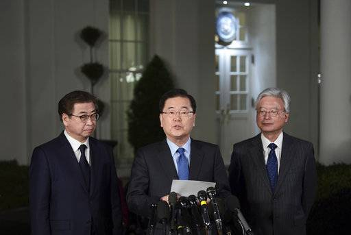South Korean national security director Chung Eui-yong, center, speaks to reporters at the White House in Washington, Thursday, March 8, 2018, as intelligence chief Suh Hoon, left and Cho Yoon-je, the South Korea ambassador to United States listen. President Donald Trump has accepted an offer of a summit from the North Korean leader and will meet with Kim Jong Un by May, a top South Korean official said in a remarkable turnaround in relations between two historic adversaries