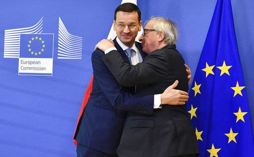 European Commission President Jean-Claude Juncker, right, greets Polish Prime Minister Mateusz Morawiecki prior to a meeting at EU headquarters in Brussels on Thursday, March 8, 2018.
