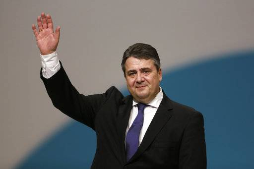 FILE - In this Dec. 11, 2015 file photo German Foreign Minister Sigmar Gabriel waves to the delegates as he receives the applause after his speech during the Social Democratic party convention in Berlin.