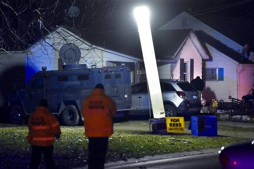 Law enforcement officials respond to the scene of a shooting where officer Christopher Ryan Morton was killed and two other officers wounded as they responded to a 911 call on Tuesday evening, March 6, 2018, in Clinton, Mo. (Keith Myers/The Kansas City Star via AP)