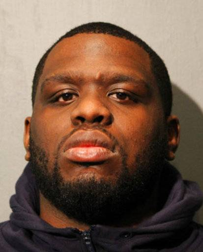 This photo provided by the Chicago Police Department shows Paris McKinley, Summit, Ill., who was charged after a Chicago police officer was dragged by a minivan for several blocks following a traffic stop. Police announced charges Thursday, March 8, 2018, against McKinley including aggravated fleeing, armed violence and being a parolee in possession of a weapon. (Chicago Police Department via AP)