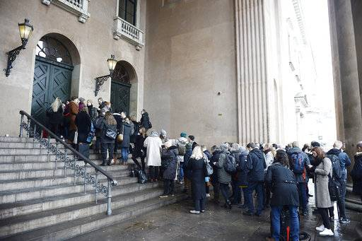 Members of the media queue up in front of the courthouse in Copenhagen Denmark where the trial of Danish inventor Peter Madsen, charged with murdering and dismembering Swedish journalist Kim Wall aboard his homemade submarine begins, in Copenhagen, Thursday, March 8, 2018. (Mads Claus Rasmussen/Ritzau via AP)