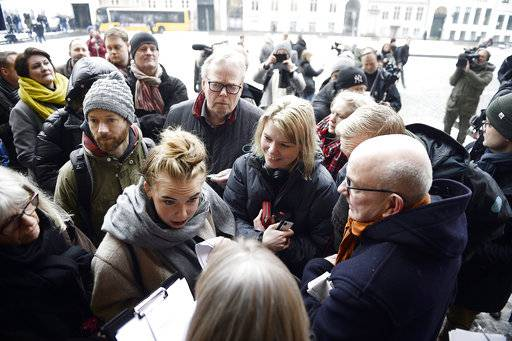 Members of the media queue up in front of the courthouse where the trial of Danish inventor Peter Madsen, charged with murdering and dismembering Swedish journalist Kim Wall aboard his homemade submarine begins, in Copenhagen, Thursday, March 8, 2018. (Mads Claus Rasmussen/Ritzau via AP)