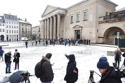 Members of the media set up in front of the courthouse where the trial of Danish inventor Peter Madsen, charged with murdering and dismembering Swedish journalist Kim Wall aboard his homemade submarine begins, in Copenhagen, Thursday, March 8, 2018. (Mads Claus Rasmussen/Ritzau via AP)