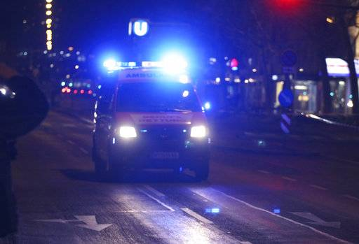An ambulance drives on the street after several people have been injured in a knife attack on the streets of Vienna, Austria, Wednesday, March 7, 2018.