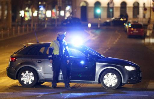 An officer blocks a street when police is on the hunt for an attacker after several people have been injured in a knife attack on the streets of Vienna, Austria, Wednesday, March 7, 2018.