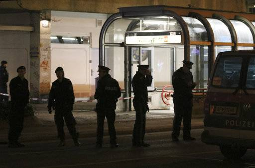 Officers stand at the underground stop Nestroyplatz when police is on the hunt for an attacker after several people have been injured in a knife attack on the streets of Vienna, Austria, Wednesday, March 7, 2018.