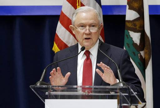 U.S. Attorney General Jeff Sessions addresses the California Peace Officers' Association 26th Annual Law Enforcement Legislative Day, 7, 2018, in Sacramento, Calif. The Trump administration on Tuesday sued to block California laws that extend protections to people living in the U.S. illegally.