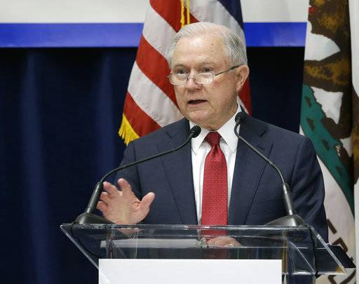 U.S. Attorney General Jeff Sessions addresses the California Peace Officers' Association at the 26th Annual Law Enforcement Legislative Day, Wednesday, March 7, 2018, in Sacramento, Calif. Sessions told law enforcement officers at the conference Wednesday that the Justice Department sued California because state laws are preventing federal immigration agents from doing their jobs.