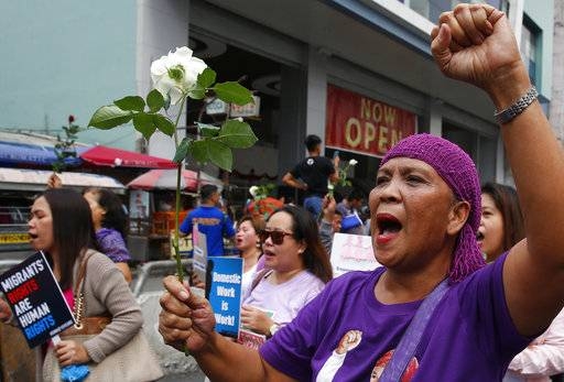 Protesters shout slogans as they march towards a Manila square for a rally to mark International Women's Day Thursday, March 8, 2018 in Manila, Philippines. Hundreds of women activists in pink and purple shirts protested against President Rodrigo Duterte in the Philippines on Thursday, as marches and demonstrations in Asia kicked off International Women's Day.