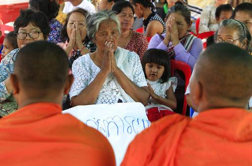 Land activists from Boeung Chhuk community offer prayers to Buddhist monks to mark International Women's Day on the outskirts of Phnom Penh, Cambodia, Thursday, March 8, 2018. The community people took part in the International Women's Day celebration, coincided with the 10th anniversary of their forced eviction.