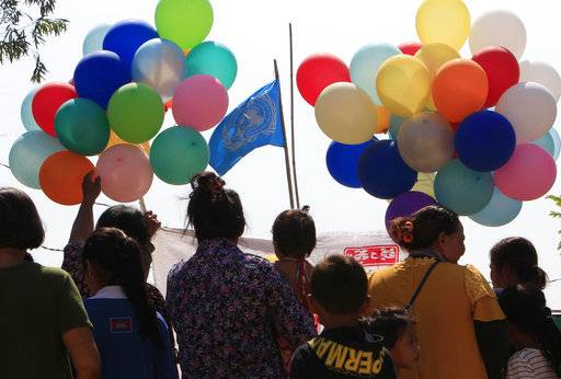 Land activists from Boeung Chhuk community wait to release balloons to mark International Women's Day on the outskirts of Phnom Penh, Cambodia, Thursday, March 8, 2018. The community people took part in the International Women's Day celebration, coincided with the 10th anniversary of their forced eviction.