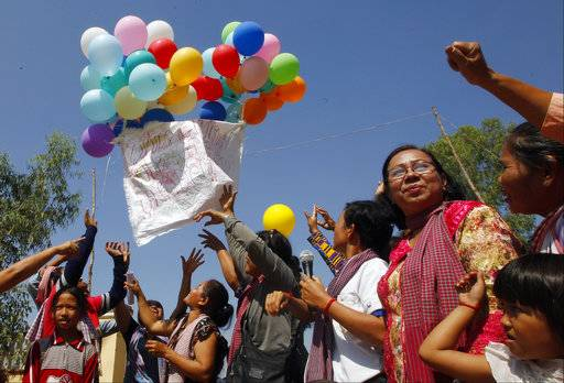 Land activists from Boeung Chhuk community release balloons to mark International Women's Day on the outskirts of Phnom Penh, Cambodia, Thursday, March 8, 2018. The community people took part in the International Women's Day celebration, coincided with the 10th anniversary of their forced eviction.