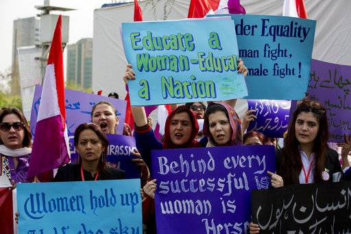 People take part in a rally to mark International Women's Day in Islamabad, Pakistan, Thursday, March 8, 2018.