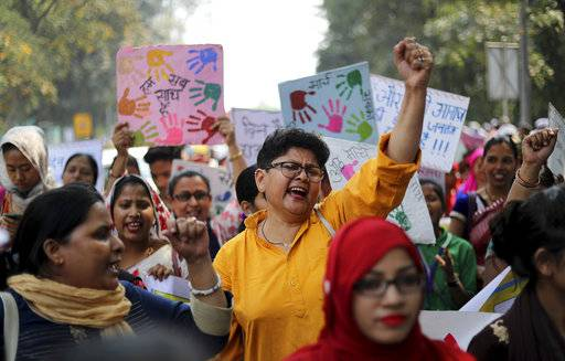 Indian women shout slogans during a march to observe International Women's Day in New Delhi, India, Thursday, March 8, 2018. Hundreds of women held street plays and march in the Indian capital highlighting domestic violence, sexual attacks and discrimination in jobs and wages against them. Violent crime against women has been on the rise in India despite tough laws enacted by the government.