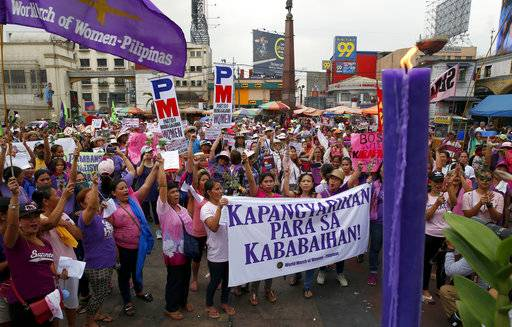 Protesters shout slogans during a rally to mark International Women's Day Thursday, March 8, 2018 in Manila, Philippines. Hundreds of women activists in pink and purple shirts protested against President Rodrigo Duterte in the Philippines on Thursday, as marches and demonstrations in Asia kicked off International Women's Day.
