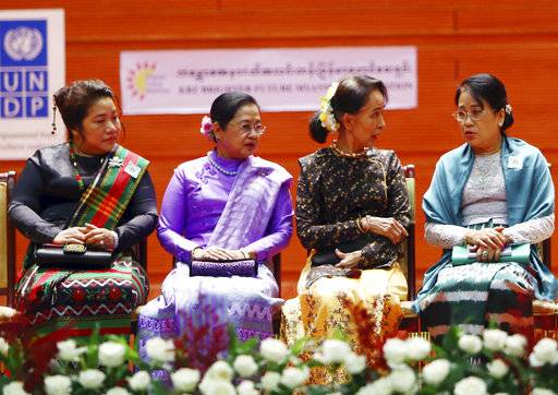Myanmar's leader Aung San Suu Kyi, second right, Myanmar first lady Su Su Lwin, second left, Khan Thet Htay, right, wife of Myanmar Vice President Myint Swe, and Shwe Lwan, wife of Myanmar Vice President Henry Van Hti Yu, speak during a photo session following a ceremony to mark International Women's Day at the Myanmar International Convention Centre in Naypyitaw, Myanmar, Thursday, March 8, 2018.
