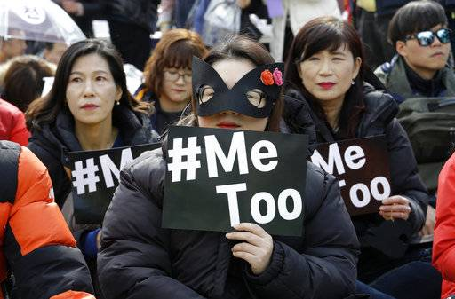 Female workers supporting the MeToo movement wearing black attend a rally to mark the International Women's Day in Seoul, South Korea, Thursday, March 8, 2018.